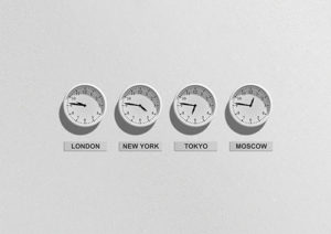 clocks with different times on a wall